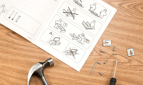 Page of Ikea furniture assembly instructions with hammer and nails